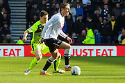 Derby County midfielder Jacob Butterfield holds the ball up during the Sky Bet Championship match between Derby County and Huddersfield Town at the iPro Stadium, Derby, England on 5 March 2016. Photo by Aaron Lupton.