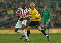 Photo: Leigh Quinnell.<br /> Watford v Stoke City. Coca Cola Championship.<br /> 14/01/2006. Watfords Jay De Merit clashes with Stokes Mamady Sidibe.