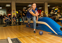 Melissa Thistle bowls for Team Paws Off while cheered on by her teammates Wendy Clark, Erica Cook and Chistine Gobeil during the NH Humane Society Indoor Triathlon at Funspot Saturday.  (Karen Bobotas/for the Laconia Daily Sun)