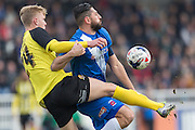 Hartlepool United striker Billy Paynter and Joe Worrall (Defender) Dagenham & Redbridge compete for the ball during the Sky Bet League 2 match between Hartlepool United and Dagenham and Redbridge at Victoria Park, Hartlepool, England on 12 March 2016. Photo by George Ledger.