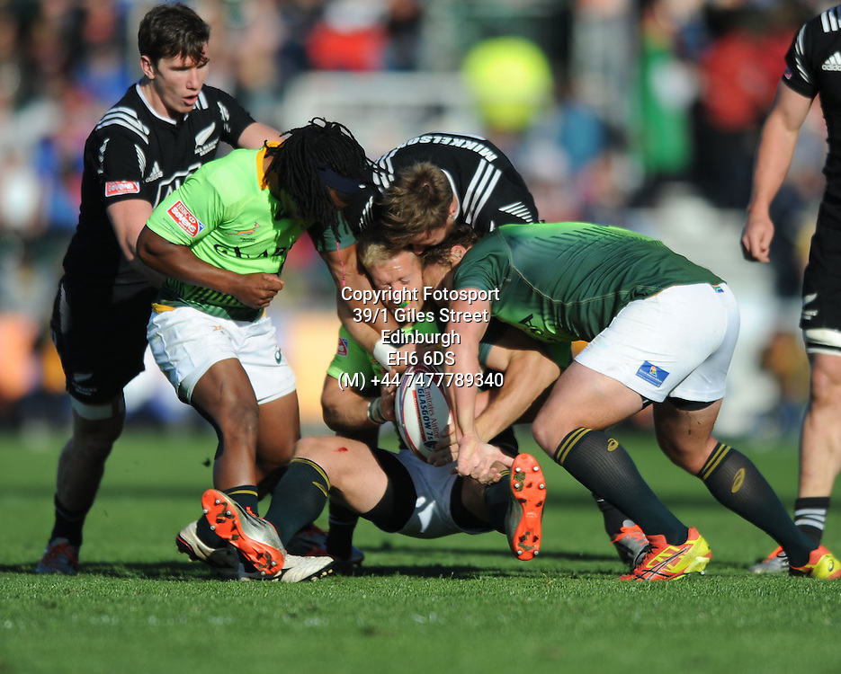 Kyle Brown - South Africa is wrapped up by Tim Mikkelson - New Zealand.<br />New Zealand v South Africa, IRB Glasgow Sevens, Scotstoun stadium, Glasgow, Scotland, United Kingdom, Saturday 9 May 2015<br />Please credit: Fotosport/David Gibson