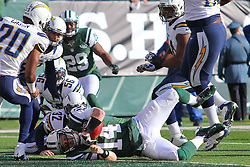 Dec 23, 2012; East Rutherford, NJ, USA; New York Jets quarterback Greg McElroy (14) dives for a first down during the first half of their game against the San Diego Chargers at MetLIfe Stadium.