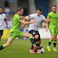 TELFORD COPYRIGHT MIKE SHERIDAN Aaron Williams of Telford is tackled by Rory McAuley of Kings Lynn during the National League North fixture between AFC Telford United and Kings Lynn Town at the Bucks Head on Tuesday, August 13, 2019<br /> <br /> Picture credit: Mike Sheridan<br /> <br /> MS201920-009