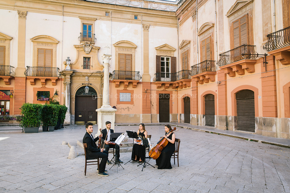 PALERMO, ITALY - 16 JUNE 2018: Musicians rehearse in the historical center of Palermo during  Manifesta 12, the European nomadic art biennal, in Palermo, Italy, on June 16th 2018.<br /> <br /> Manifesta is the European Nomadic Biennial, held in a different host city every two years. It is a major international art event, attracting visitors from all over the world. Manifesta was founded in Amsterdam in the early 1990s as a European biennial of contemporary art striving to enhance artistic and cultural exchanges after the end of Cold War. In the next decade, Manifesta will focus on evolving from an art exhibition into an interdisciplinary platform for social change, introducing holistic urban research and legacy-oriented programming as the core of its model.<br /> Manifesta is still run by its original founder, Dutch historian Hedwig Fijen, and managed by a permanent team of international specialists.<br /> <br /> The City of Palermo was important for Manifesta&rsquo;s selection board for its representation of two important themes that identify contemporary Europe: migration and climate change and how these issues impact our cities.