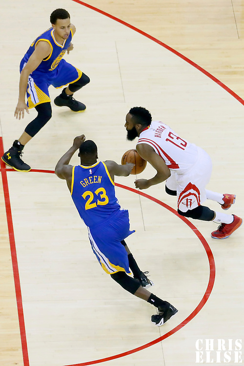 23 May 2015: Houston Rockets guard James Harden (13) drives past Golden State Warriors forward Draymond Green (23) during the Golden State Warriors 115-80 victory over the Houston Rockets, in game 3 of the Western Conference finals, at the Toyota Center, Houston, Texas, USA.