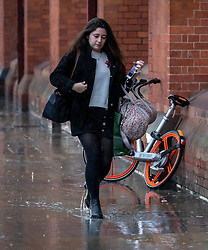 © Licensed to London News Pictures. 20/12/2019. Train Passengers battle in the rain  as the Christmas Getaway starts at St Pancras Station. Heavy rain today is causing chaos for the  thousands who are expected to travel for the festive period: Alex Lentati/LNP