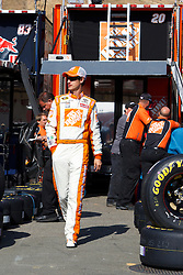 June 25, 2011; Sonoma, CA, USA;  Sprint Cup Series driver Joey Logano (20) walks to his car before practice for the Toyota/Save Mart 350 at Infineon Raceway.