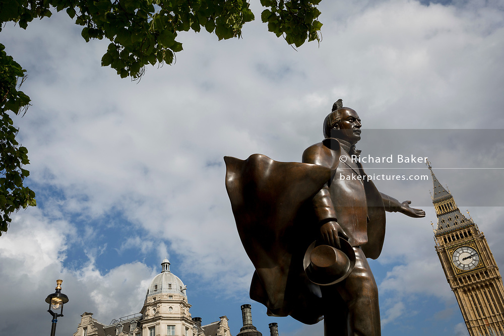 The statue to Liberal politician David Lloyd George which stands in Parliament Square, below the Elizabeth Tower and the Houses of Parliament, on 12th September 2017, in London, England. David Lloyd George 1st Earl Lloyd-George of Dwyfor was a British Liberal politician and statesman. The statue of former British Prime Minister David Lloyd George is by Glynn Williams is located at Parliament Square in London and stands 8 feet (2.4 m) tall. Unveiled in October 2007 it was funded by the David Lloyd George Statue Appeal, a charitable trust supported in part by HRH The Prince of Wales.