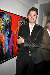 JESPER THOMSEN at a private view of paintings by Johnny Madsen at Mews 42 Gallery, 42 Princes Gate Mews,  South Kensington, London on 15th April 2009.