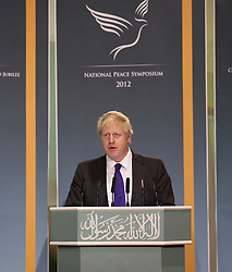 © Licensed to London News Pictures. 24/03/2012. Surrey, U.K..Boris Johnson at Europe's largerst mosque, Baitul Futuh Mosque, in Morden, Surrey, which holds 10,000 worshipers. .Parliamentarians and religious, civic, charitable and community leaders meet here this evening 24/3/2012 for a National Peace Symposium on International Peace organised by the Ahmadiyya Muslim community to hear how Muslims are countering extremism..Photo credit : Rich Bowen/LNP