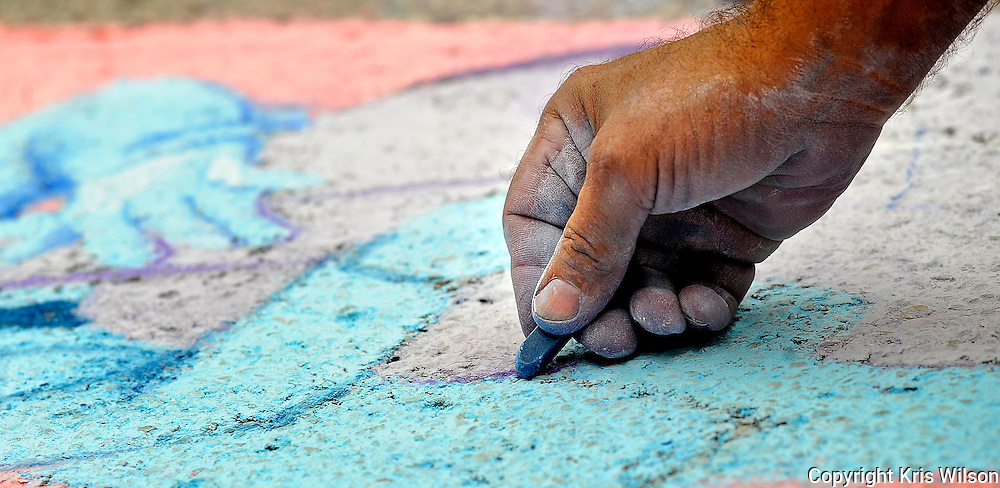St. Charles artist Rich Vigil meticulously details his street chalk tribute to jazz during downtown Jefferson City's Connect to the Arts Festival and 20th annual Capital Jazzfest.