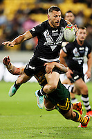 LEWIS BROWN IS TACKLED BY COREY PARKER DURING THE 2014 FOUR NATIONS FINAL, WELLINGTON