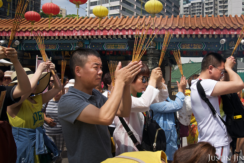 Worshippers pray at the Wong Tai Sin temple in Hong Kong.