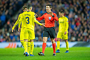 Referee Matej Jug (SVN) speaks to Alvaro Gonzalez (#3) of Villarreal CF during the Europa League group stage match between Rangers FC and Villareal CF at Ibrox, Glasgow, Scotland on 29 November 2018.