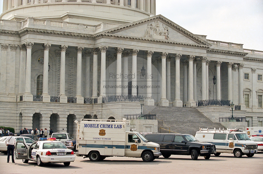 Emergency vehicles and police respond to a shooting at the US Capitol July 24, 1998 in Washington, DC. Two US Capitol police officers were killed in the incident, one person wounded and the lone gunmen was wounded and taken into custody.
