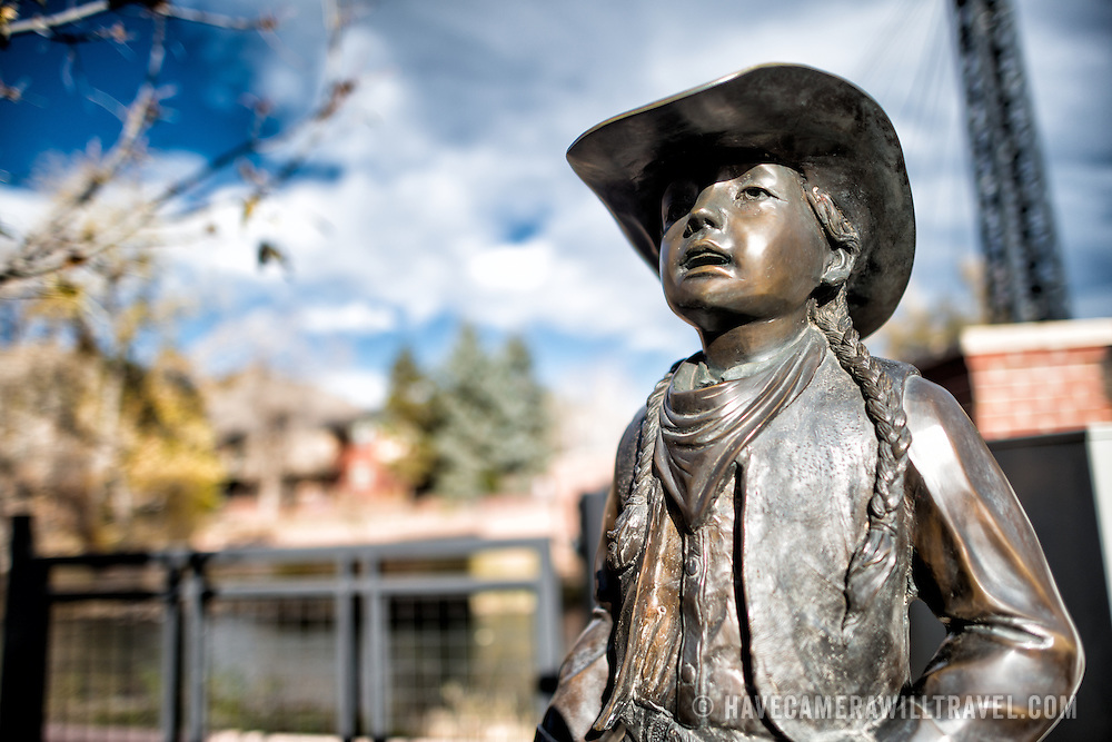 A statue of a girl in western dress in Golden, Colorado, just outside Denver at the eastern edge of the Rocky Mountains.