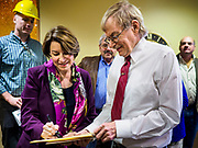 12 APRIL 2019 - NEVADA, IOWA: US Senator AMY KLOBUCHAR (D-MN) signs an autograph during a visit to Lincolnway Energy, an ethanol plant in Nevada, IA. Sen. Klobuchar is touring Iowa this weekend to support her bid for the Democratic nomination of for the US Presidency. Iowa traditionally hosts the the first election event of the presidential election cycle. The Iowa Caucuses will be on Feb. 3, 2020.          PHOTO BY JACK KURTZ