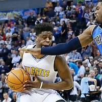 06 March 2016: Denver Nuggets guard Emmanuel Mudiay (0) is fouled by Dallas Mavericks guard Wesley Matthews (23) during the Denver Nuggets 116-114 overtime victory over the Dallas Mavericks, at the Pepsi Center, Denver, Colorado, USA.