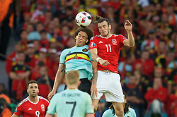 LILLE, FRANCE - Friday, July 1, 2016: Wales' Gareth Bale in action against Belgium's Axel Witsel during the UEFA Euro 2016 Championship Quarter-Final match at the Stade Pierre Mauroy. (Pic by Paul Greenwood/Propaganda)