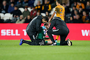 Barry Bannan of Sheffield Wednesday receives treatment during the EFL Sky Bet Championship match between Hull City and Sheffield Wednesday at the KCOM Stadium, Kingston upon Hull, England on 1 October 2019.