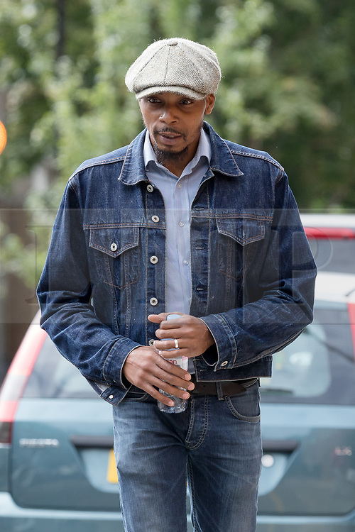 © Licensed to London News Pictures. 16/08/2017. LONDON, UK. ESA CHARLES, father of Rashan Charles arrives at the opening of the inquest into the death of Rashan Charles at Poplar Coroner's Court in east London. Rashan Charles died after being chased by police in Dalston on 22nd July and his death sparked protests and violent clashes with police officers. No cause of death has yet been determined.  Photo credit: Vickie Flores/LNP