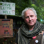 "Dave lives on and off the site helping to protect the site. He was so incensed by what was planned for Leith Hill and the arrongance and sleaze by the company that he had to join in. ""Thee is a great potential for disaster. Only a handfull will make any money and not any locals and the wild life will suffer - it will take 100s of years to restore.""Europa Oil and Gas company has got license to drill for oil in the woods near Leith Hill.  Proetctors of the land, a group of local campaigners against the proposed drilling and activists have set up a community camp on Coldharbour Lane to  protect Leith Hill from the unconventional oil exploration, through monitoring, awareness raising, and peaceful community action."