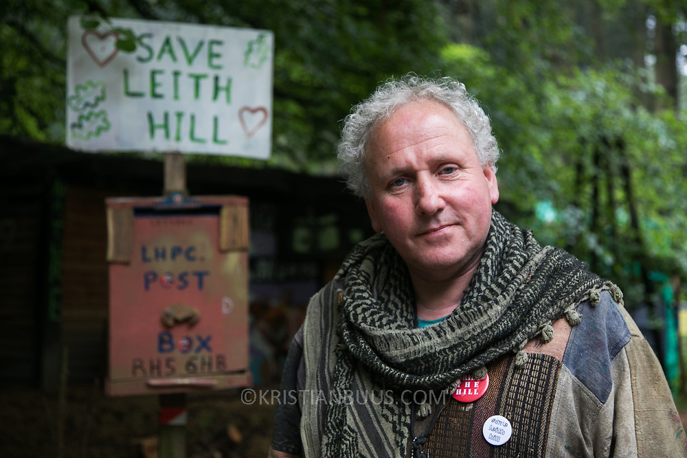 """Dave lives on and off the site helping to protect the site. He was so incensed by what was planned for Leith Hill and the arrongance and sleaze by the company that he had to join in. """"Thee is a great potential for disaster. Only a handfull will make any money and not any locals and the wild life will suffer - it will take 100s of years to restore.""""Europa Oil and Gas company has got license to drill for oil in the woods near Leith Hill.  Proetctors of the land, a group of local campaigners against the proposed drilling and activists have set up a community camp on Coldharbour Lane to  protect Leith Hill from the unconventional oil exploration, through monitoring, awareness raising, and peaceful community action."""