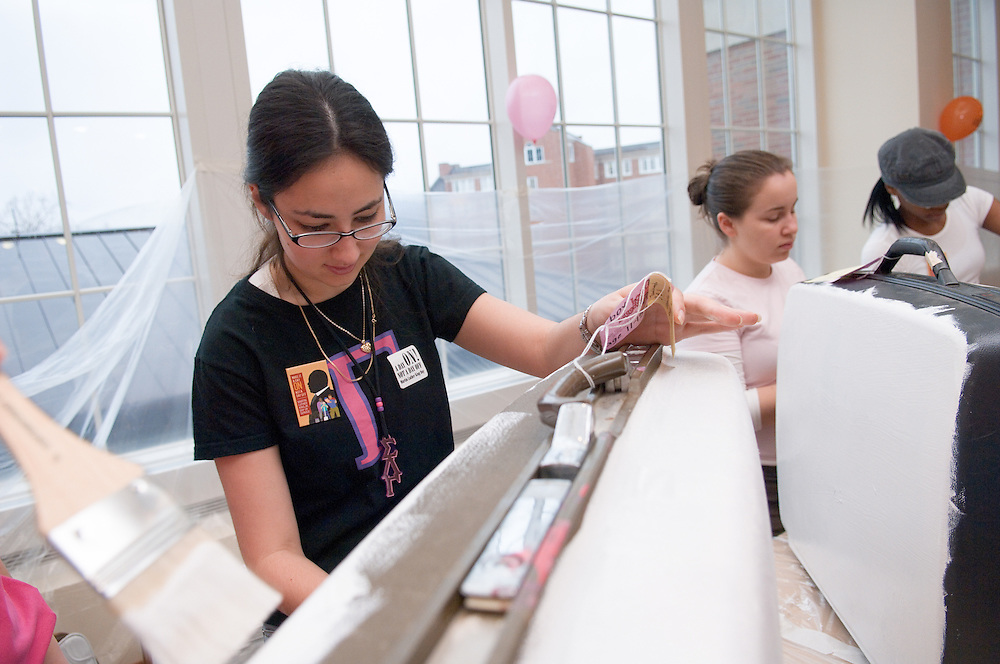 Selina Rivera & Jessica Canbning(right), Ayris Colvin(far right) Painting ...Off-Campus and Community Services presents Martin Luther King Jr. Day Love Luggage Project Love Luggage is a service project to decorate second-hand suitcases and fill them with necessities and small gifts for children in foster and shelter care. Donations are needed: suitcases, toiletries, art supplies, school supplies, books, journals, and small toys.