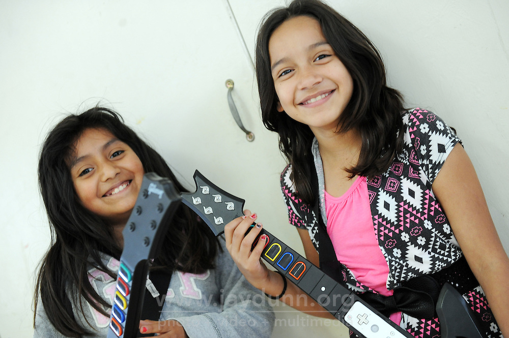 Friends Emily Velasco, left, and Andrea Soltero, both 9, getting ready for a Guitar Hero session at the Hebbron Family Center in Salinas.