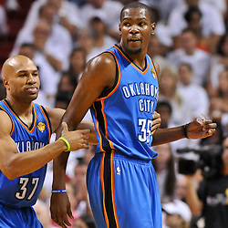 Jun 17, 2012; Miam, FL, USA; Oklahoma City Thunder small forward Kevin Durant (35) and point guard Derek Fisher (37) during the first quarter in game three in the 2012 NBA Finals against the Miami Heat at the American Airlines Arena. Mandatory Credit: Derick E. Hingle-US PRESSWIRE