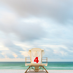Pensacola Beach Florida lifeguard tower four on Casino Beach. Pensacola Beach is on Santa Rosa Island in the Emerald Coast area of the Southeastern United States of America. Photo is vertical and high resolution. Copyright ⓒ 2018 Paul Velgos with All Rights Reserved.