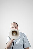 Man talking through megaphone