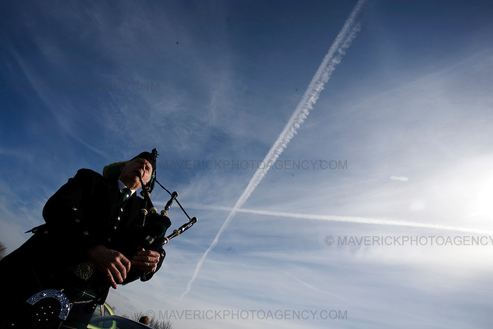 Lyle Crawford from North Berwick Pipe band plays the pipes in front of a St Andrews cross in the sky in Athelstaneford...Bands from the Royal Scots Association of Pipe Bands perform at the final Tartan Week parade in East Lothian to celebrate the Homecoming Scotland initiative.....05/4/09.Michael Hughes/Maverick.Tel. 07789681770