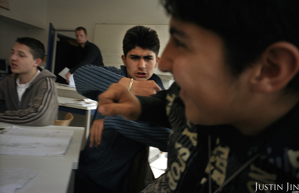 Dutch-Turkish teenagers wrestle one another during a lesson at a the De Meer pre-vocational school in Amsterdam East..The school is pre-dominantly made up of kids of Turkish and Moroccan backgrounds.  .Picture shot in Amsterdam in 2004 by Justin Jin. .