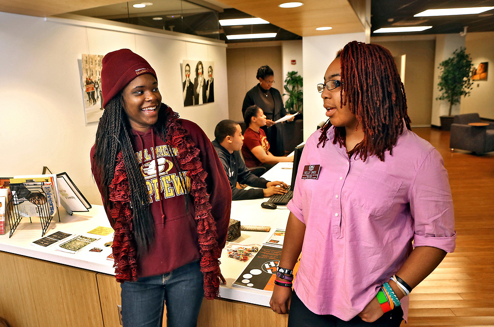 Students Denesha Sangster, of Saginaw, (left) and Kelly Okoe, of Chicago, (right) talk in the Center for Inclusion and Diversity in the University Center. Central Michigan University photo by Steve Jessmore