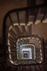 General view looking down the spiral staircase within the Elizabeth Tower, consisting of 334 steps, at the Palace of Westminster, London.