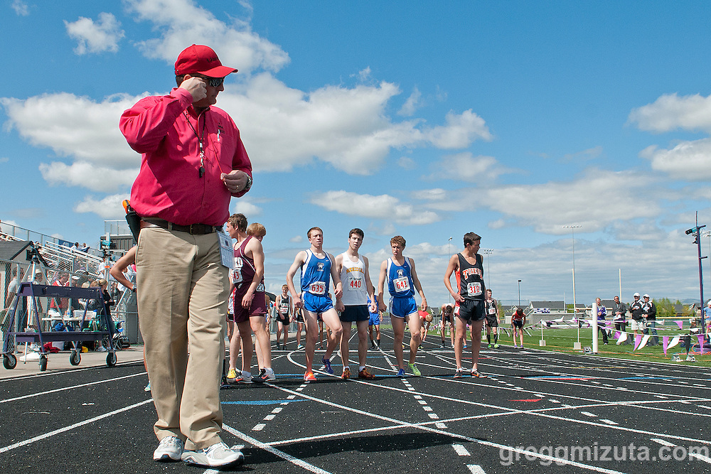 Starter Dan Murphy puts in his ear plugs before the start of the YMCA Track and Field Invite 3200 meter run on April 28, 2012 at Rocky Mountain High School, Meridian, Idaho.