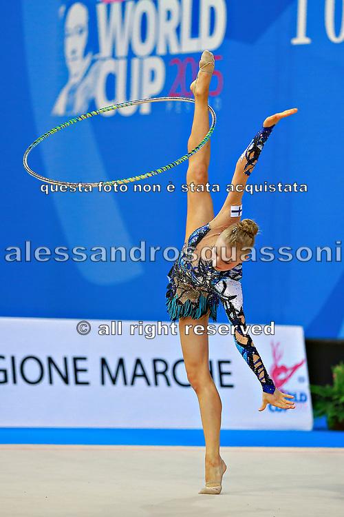 Tikkanen Jouki during qualifying at hoop in Pesaro World Cup 10 April 2015. Jouki was born July 05, 1995. She is a Finnish individual rhythmic gymnast.