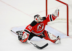 April 9, 2008; Newark, NJ, USA;  New Jersey Devils goalie Martin Brodeur (30) makes a glove save during the second period of game 1 of the Eastern Conference Quarterfinal playoffs at the Prudential Center in Newark, NJ.