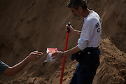 Photo by Steven St. John..Investigators break to share sunflower seeds as they search for additional human remains on Monday, March 2, 2009 on the southwestern outskirts of Albuquerque, N.M. at the site of a planned residential subdivision. Investigators and forensics experts are searching the crime scene where the remains of at least 13 bodies have been uncovered. The discovery has opened up cases involving missing prostitutes, some of whom vanished as much as 20 years ago.
