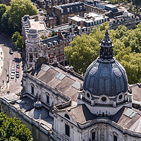 An aerial view above Kensington in London England UK with the London Oratory in the foreground. The Church of the Immaculate Heart of Mary, better known as Brompton Oratory, is home to the Congregation of the Oratory of St Philip Neri in London, a community of priests living under the rule of life established by its founder in the sixteenth century. The Oratory also serves as a parish church in the Roman Catholic Diocese of Westminster.