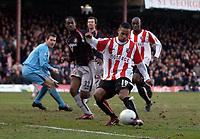 Photo: Daniel Hambury.<br />Brentford v Sunderland. The FA Cup. 28/01/2006.<br />Brentford's Dudley Campbell scores to make it 1-0.