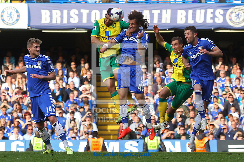 Bradley Johnson of Norwich and David Luiz of Chelsea in action during the Barclays Premier League match at Stamford Bridge, London<br /> Picture by Paul Chesterton/Focus Images Ltd +44 7904 640267<br /> 04/05/2014