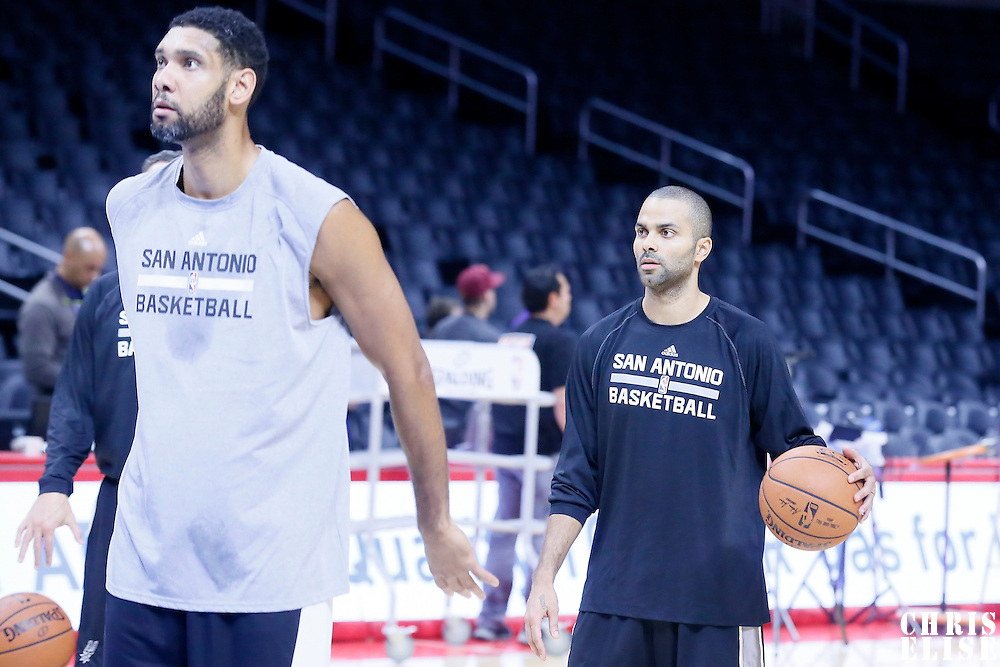 10 November 2014: San Antonio Spurs guard Tony Parker (9) warms up next to San Antonio Spurs forward Tim Duncan (21) prior to San Antonio Spurs 89-85 victory over the Los Angeles Clippers, at the Staples Center, Los Angeles, California, USA.