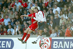 OSLO, NORWAY - Thursday, May 27, 2004:  Wales' Paul Parry in action against Norway's Christer Basma during the International Friendly match at the Ullevaal Stadium, Oslo, Norway. (Photo by David Rawcliffe/Propaganda)