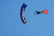 USA, Oregon, Hillsboro, USAF Academy skydiver, diving with the US Marine Corps Flag.