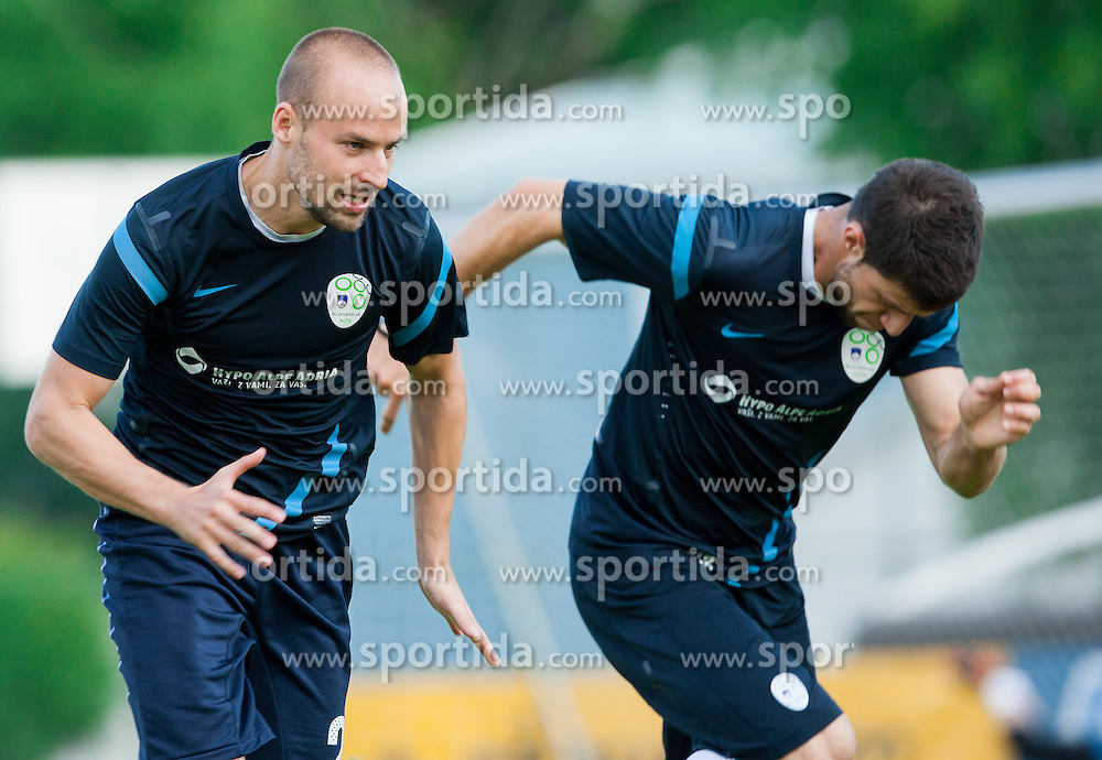 Miso Brecko and Bojan Jokic during practice session of Slovenian National football team at training camp on May 28, 2013 in Sports park Kranj, Slovenia. (Photo By Vid Ponikvar / Sportida)