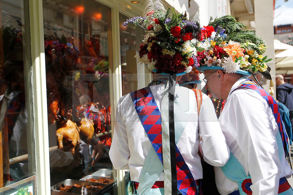 © Licensed to London News Pictures. 12/05/2012, London, UK.  Earlsdon Morris Men looks into a Chinese restaurant before their dance in China Town in London as Morris men from around the country gather in London for a Westminster Morris Men Day of Dance, Saturday, May 12, 2012. Photo credit : Sang Tan/LNP