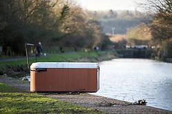 © Licensed to London News Pictures. 29/12/2015. Elland UK. A hot tub has been left stranded on the banks of the Calder & Hebble Navigation at Park Nook Lock in Elland after recent flooding.  Photo credit: Andrew McCaren/LNP