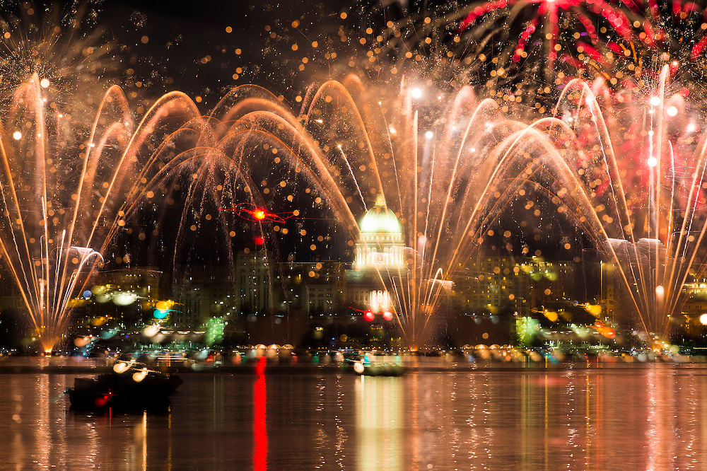 Boats dot Lake Monona as Shake the Lake fireworks light up the night sky over the downtown Madison, Wis., skyline on June 27, 2015. (Photo by Jeff Miller - www.jeffmillerphotography.com)